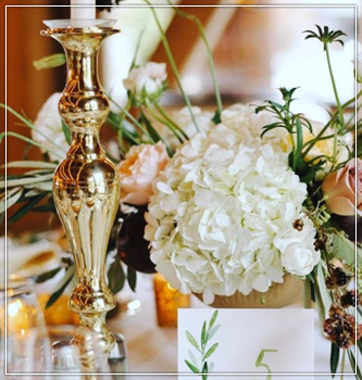 Gold Candlestick holders, Green foliage,  lanterns and white Spanish furniture in Wisconsin